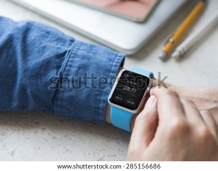 SEATTLE, USA - June 5, 2015: Man Wearing Sport Apple Watch with Blue Rubber Band.  - stock photo