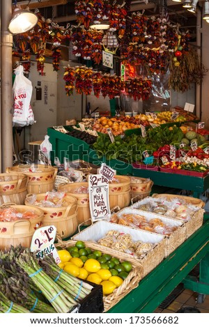 SEATTLE, USA - MAY 18, 2007: Fruits and vegetables stall at Pike Place Market in Seattle. Market opened in 1907 and is today one of the oldest continually operated public markets in the US.  - stock photo