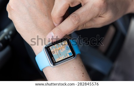 SEATTLE, USA - May 30, 2015: Man Using Maps App on Apple Watch While Driving Car - stock photo