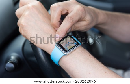SEATTLE, USA - May 30, 2015: Man Using Maps App on Apple Watch While Driving Car