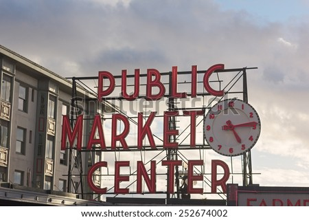 SEATTLE, USA - OCTOBER 26, 2014: Public Market Center sign in Seattle downtown on October 26, 2014. Pike street market is famous for fresh produce, delicious food and unique arts and crafts. - stock photo