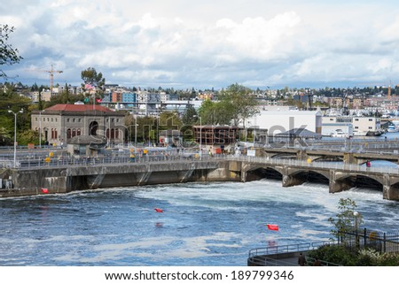 SEATTLE, WA - APR 27, 2014: Wide Angle View of the Army Corps of Engineers Hiram M. Chittenden or Ballard  Locks in Seattle, Washington. - stock photo
