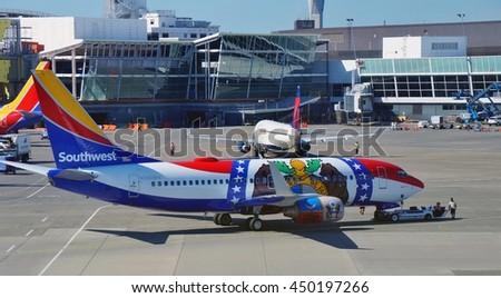 SEATTLE, WA -27 JUNE 2016- A Boeing 737-300 airplane from Southwest Airlines (WN) painted in a special Missouri One livery colors with the motto United We Stand Divided We Fail.