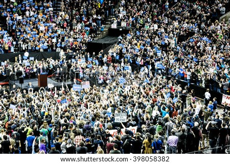 SEATTLE, WA - March 20, 2016: A massive crowd gathers in Key Arena to rally for presidential candidate Bernie Sanders - stock photo