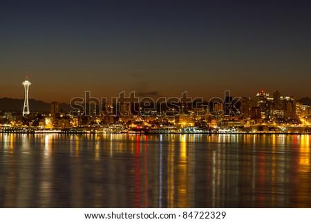 Seattle Washington City Skyline Reflection on Puget Sound at Dawn - stock photo