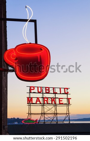 SEATTLE, WASHINGTON/UNITED STATES - SEPTEMBER 2: Neon Public Market sign and steaming cup of coffee in Pike Place Market in Seattle, Washington on September 2, 2012. - stock photo