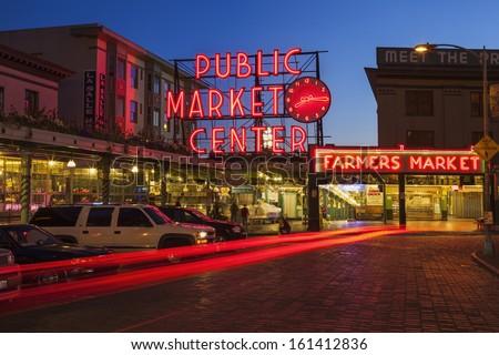 SEATTLE, WASHINGTON/UNITED STATES  - SEPTEMBER 2: The Public Market Center also known worldwide as Pike Place Market at night in Seattle, Washington on September 2, 2012. - stock photo