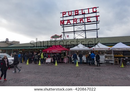 SEATTLE, WASHINGTON/USA - DECEMBER 2015: The Famous Pike Place Public Market is a Tourism Attraction on the Waterfront of Downtown Seattle.  - stock photo