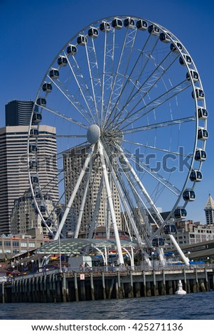 SEATTLE, WASHINGTON/USA - June 6, 2014: The Great Wheel is a giant Ferris wheel located on a Pier in the Waterfront of Seattle's Downtown at 1301 Alaskan Way, Seattle, WA