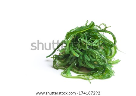 Seaweed salad with sesame seeds isloated on whitem veiw from the side - stock photo