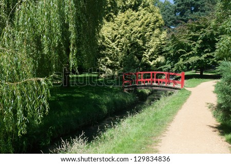 Secluded path in Bournemouth's Upper Gardens. - stock photo