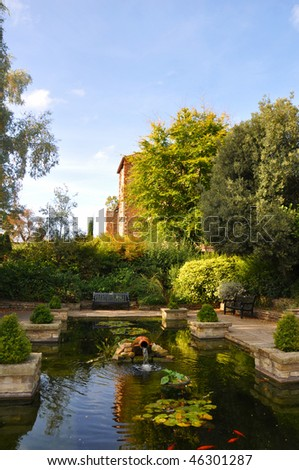 Secluded pond in the grounds of Colchester Castle - stock photo