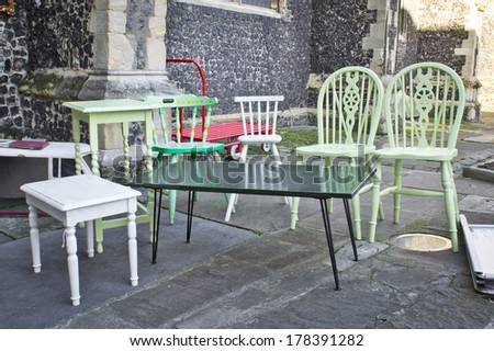 Second hand furniture for sale at a yard sale in the UK - stock photo
