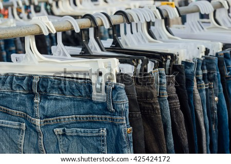 second hand jeans for sale - stock photo