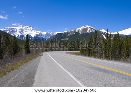 Secondary highway in the Canadian Rocky mountains - stock photo