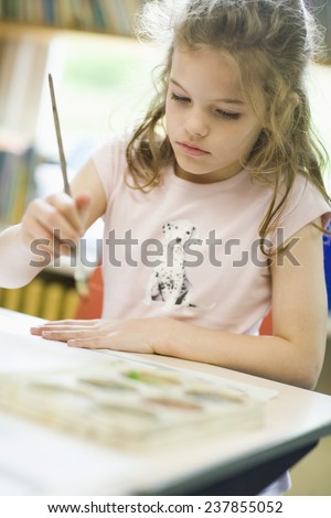 Secondary School Student in Art Class - stock photo
