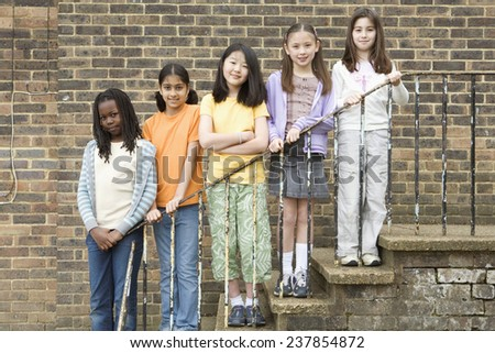 Secondary Students in Playground - stock photo