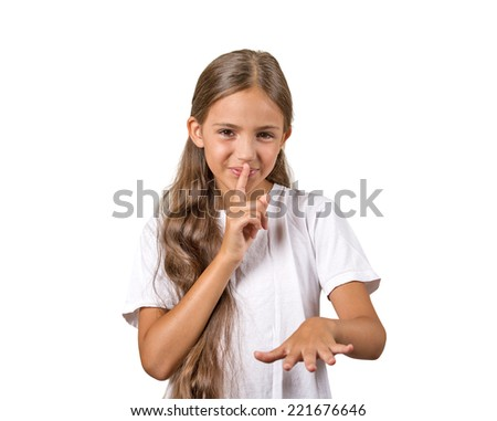 Secret. Closeup portrait teenager girl placing finger on lips mouth with shhh sign symbol, isolated white background. Human emotion facial expression feelings, body language, attitude - stock photo