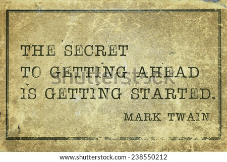 secret of getting ahead - famous Mark Twain quote printed on grunge vintage cardboard - stock photo