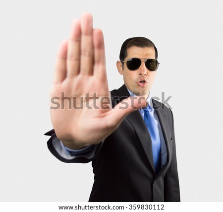 Secret service agent with open palm gesturing to stop us isolated on white background - stock photo