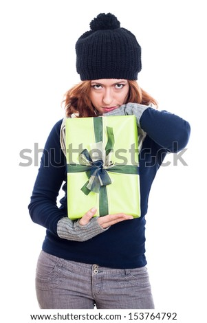 Secret winter woman holding present, isolated on white background. - stock photo