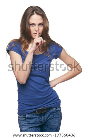 Secret woman. Beautiful woman with finger on lips, saying hush be quiet, against white background. - stock photo