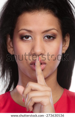 Secret woman finger on lips. Teen girl mixed race showing hand silence sign, saying hush be quiet - stock photo