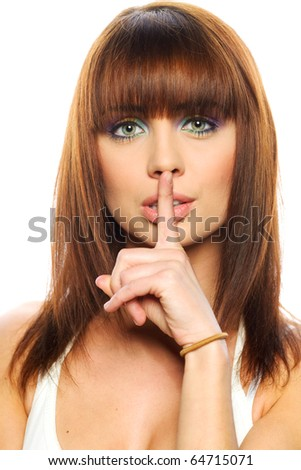secret - Young girl with her finger over her mouth