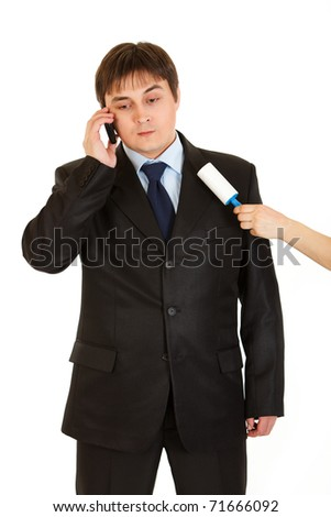 Secretary cleaning  chiefs suit while he talking on telephone isolated on white - stock photo