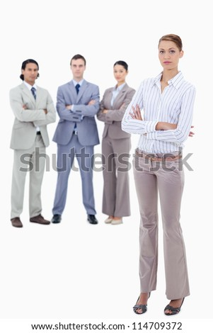 Secretary crossing her arms with serious business people behind her against white background