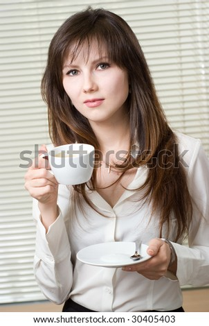 Secretary girl with a cup of coffee