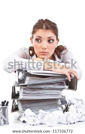 Secretary having a lot of paperwork to do - stock photo