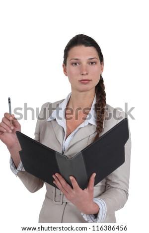 Secretary holding office supplies - stock photo
