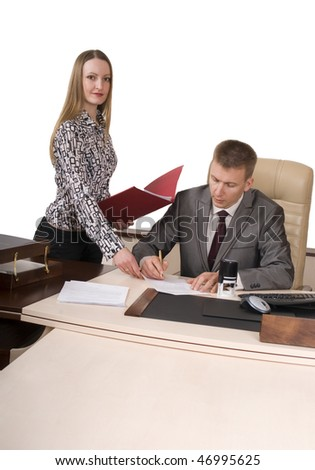 Secretary is giving documents for signing to her boss