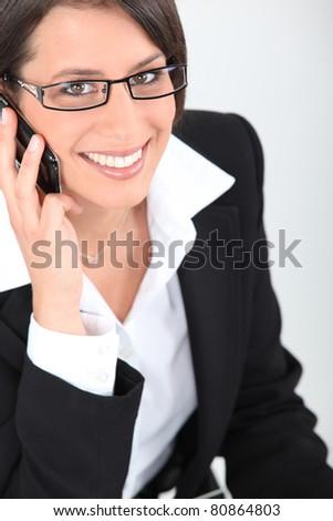 secretary on the phone - stock photo