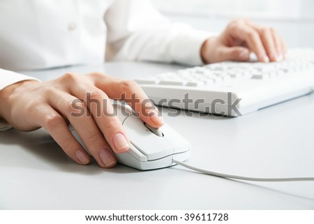 Secretary?s hand touching computer mouse during work