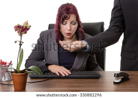 secretary sitting at desk spitting out gum into a mans hand  - stock photo