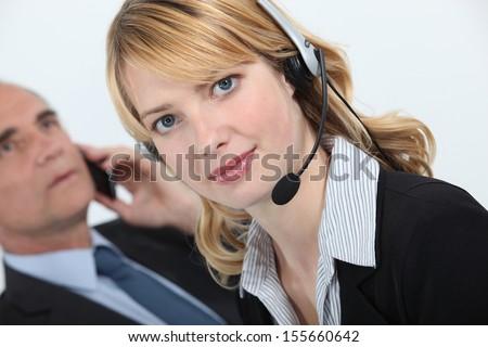 Secretary wearing a headset - stock photo