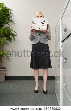 Secretary with files - stock photo