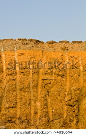 Section of asphalt road. Section of asphalt road which has been used for drilling. - stock photo