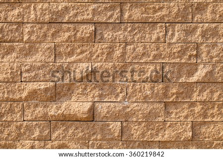 section of the wall of yellow bricks - stock photo