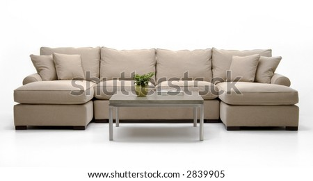 Sectional sofa and coffee table - stock photo