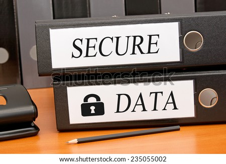 Secure Data - Two binders on desk in the office - stock photo