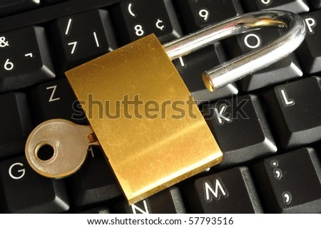 secure online banking or internet firewall concept with padlock and keyboard - stock photo