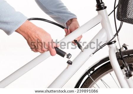 Securing the bike with a chain and key - studio shoot
