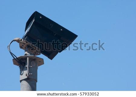 Security Camera against blue sky - stock photo