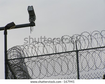 Security Camera Concertina Wire Outside Prison Stock Photo (Safe to ...