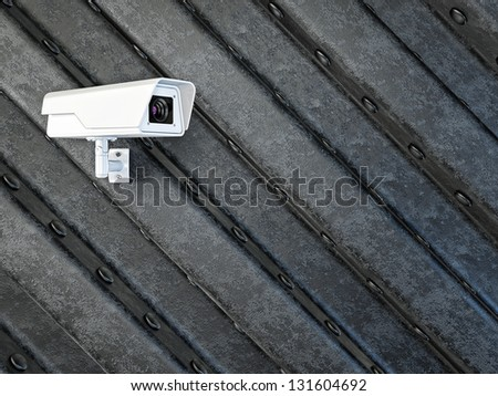 security camera attached  on a black wall - stock photo