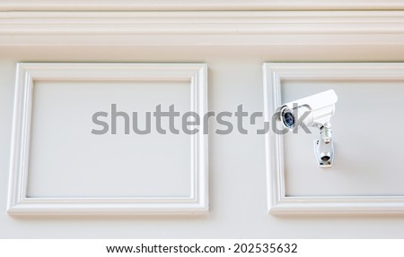 Security Camera CCTV on wall - stock photo