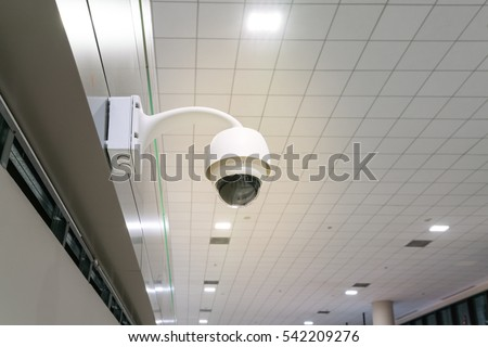 Security camera in the place  - CCTV camera in the office building with copy space